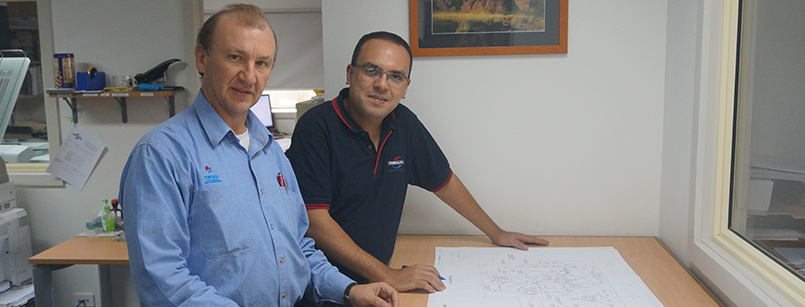 Mechanical engineers drafting plans at Insulpak