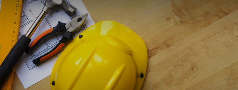 A yellow hard hat and other tools